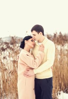 Sensual couple in winter field