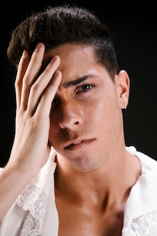 Sensual crying male model in blouse