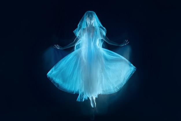 A sensual and emotional dance of beautiful ballerina through the veil