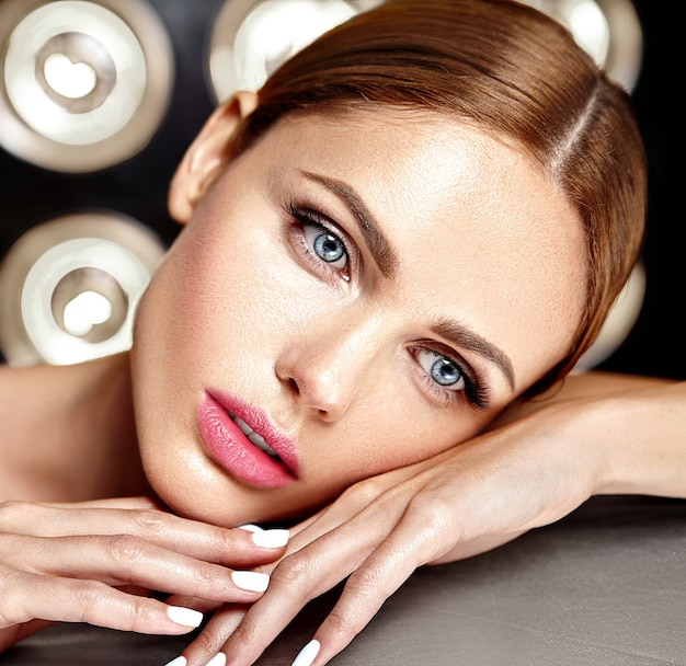 Sensual glamour beautiful woman model with fresh daily makeup with nude lips color and clean healthy skin face