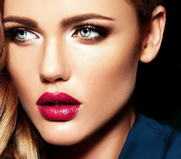 Sensual glamour portrait of beautiful blond woman model lady with fresh daily makeup with pink lips color and clean healthy skin