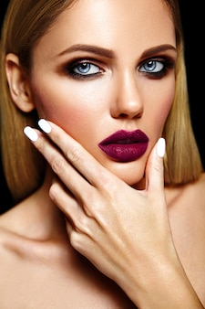 Sensual glamour portrait of beautiful blond woman model lady with fresh daily makeup with purple lips color and clean healthy skin