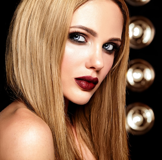 Sensual glamour portrait of beautiful blond woman model lady with fresh daily makeup with red lips color and clean healthy skin