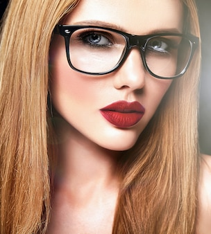Sensual glamour portrait of beautiful blond woman model with fresh daily makeup with purple lips color and clean healthy skin in glasses