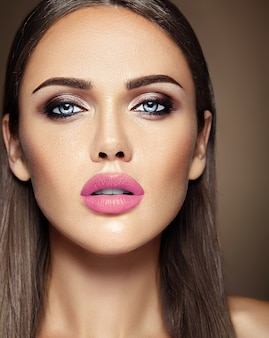 Sensual glamour portrait of beautiful  woman model lady with fresh daily makeup with pink lips color and clean healthy skin face