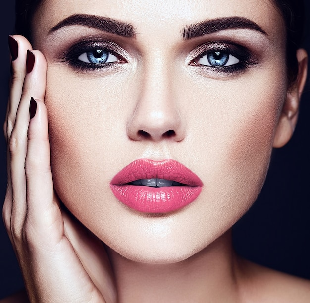 Sensual glamour portrait of beautiful  woman model lady  with pink lips color and clean healthy skin face
