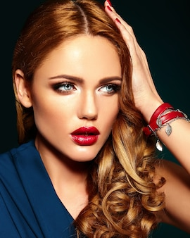 Sensual glamour portrait of beautiful woman model with fresh daily makeup with red lips color and clean healthy skin