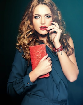 Sensual glamour portrait of beautiful woman model with fresh daily makeup with red lips color and clean healthy skin.