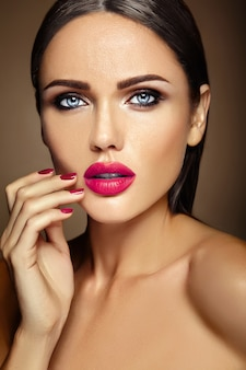 Sensual glamour warm portrait of beautiful  woman model lady with fresh daily makeup with pink lips color and clean healthy skin face