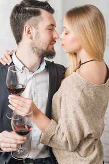 Sensual loving couple with wine