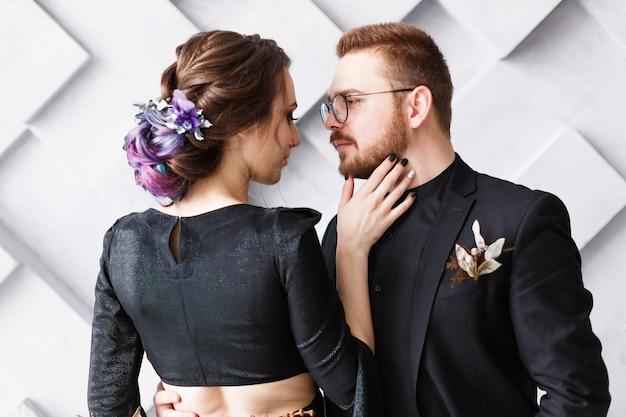 Sensual portrait of couple close-up. wedding photography on gray geometric background.