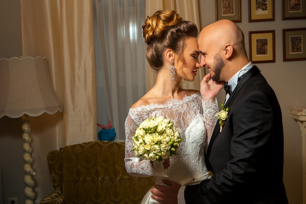 Sensual portrait of just merried couple at home
