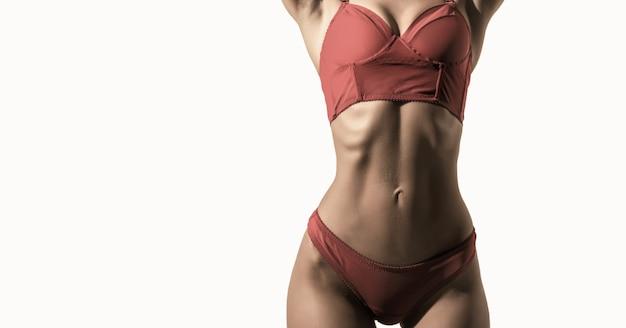 Sensual waist sexy woman in elegant red underwear athletic body slim waist sexy girl