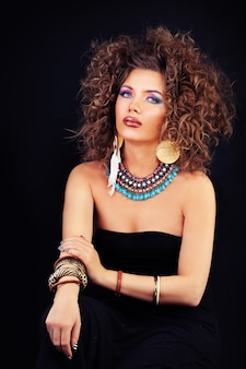 Sensual woman fashion model with makeup and permed hairstyle