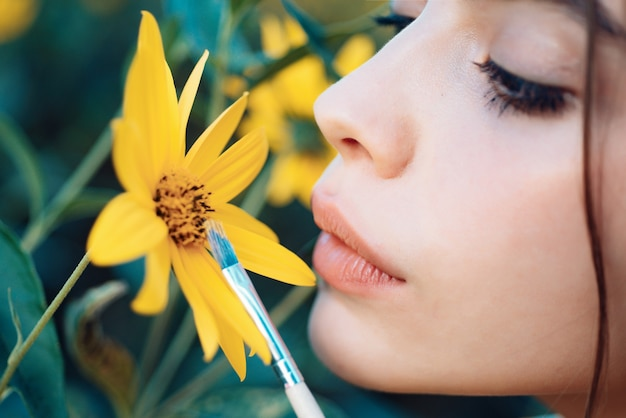 Sensual woman lips nature girl concept spring painting yellow spring mood spring lipstick