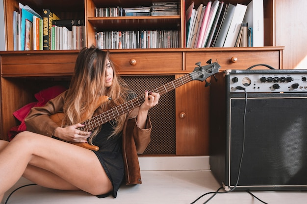 Sensual woman playing guitar