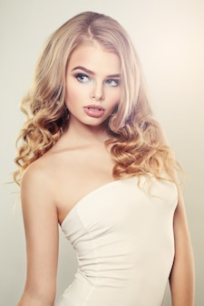 Sensual woman with blonde curly hair
