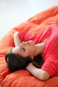 Sensual young woman dreaming on a blanket