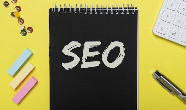 Seo acronym inscription on black and yellow background. digital marketing.