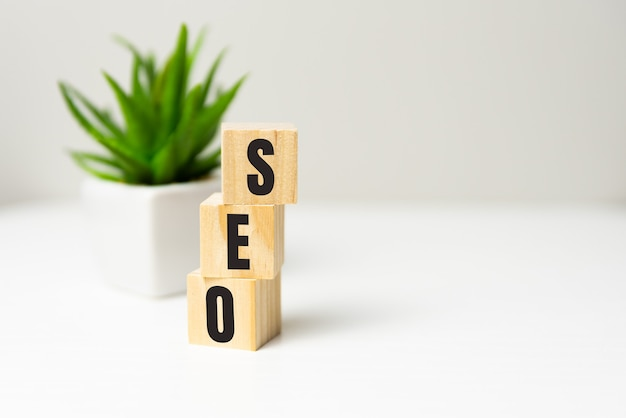 Seo - text on wooden cubes, on wooden background.
