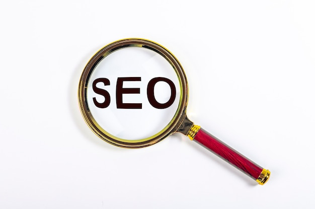 Seo word, acronym through magnifying glass or loupe