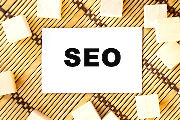 Seo word on wooden cubes. concept wooden box on a beautiful wooden background