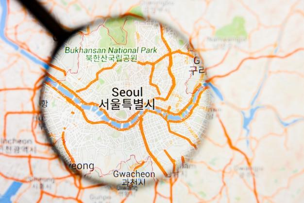 Сеул, южная корея, город визуализация иллюстративная концепция на экране дисплея через увеличительное стекло
