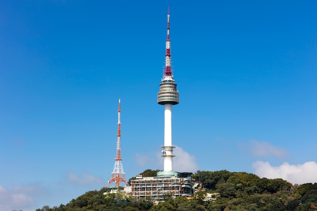 Seoul tower located on namsan mountain with blue sky white clouds  in seoul, south korea.