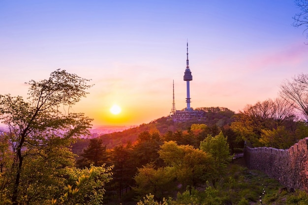 Seoul tower in sunset and old wall on namsan mountain