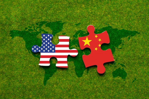 Separate two jigsaw puzzle with us and china flags inside
