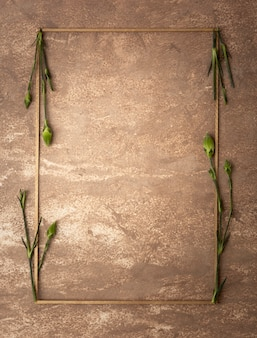 Sepia frame with small carnation stems