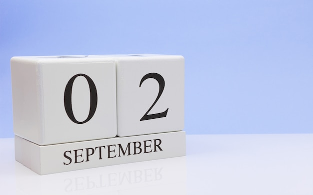 September 02st. day 2 of month, daily calendar on white table with reflection