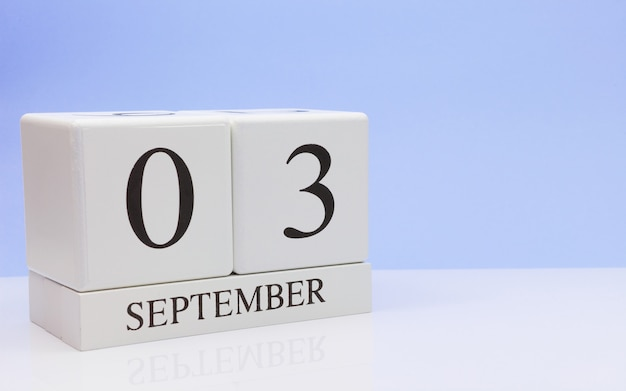 September 03st. day 3 of month, daily calendar on white table with reflection