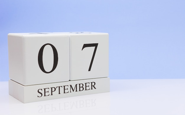 September 07st. day 7 of month, daily calendar on white table with reflection