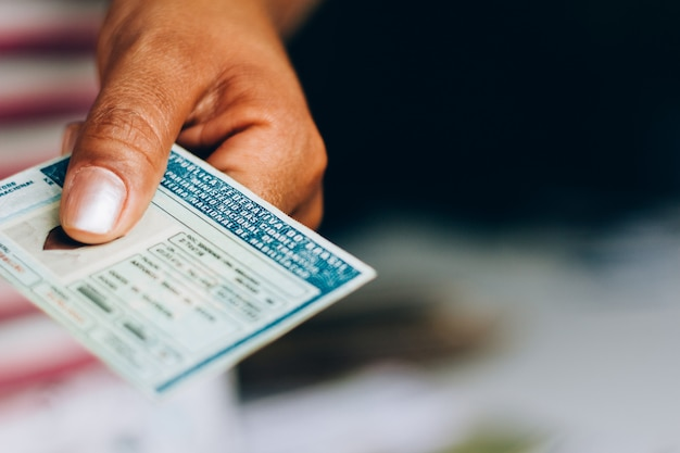 September 10, 2019, brazil. man holds national driver's license (cnh). official document of brazil, which attests the ability of a citizen to drive land vehicles.