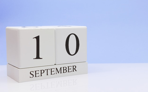 September 10st. day 10 of month, daily calendar on white table with reflection