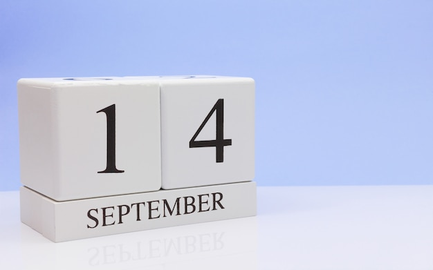 September 14st. day 14 of month, daily calendar on white table with reflection