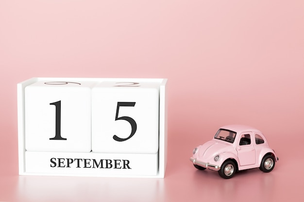 September 15th. day 15 of month. calendar cube with car
