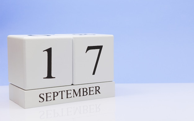September 17st. day 17 of month, daily calendar on white table with reflection