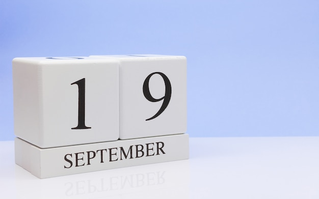 September 19st. day 19 of month, daily calendar on white table with reflection