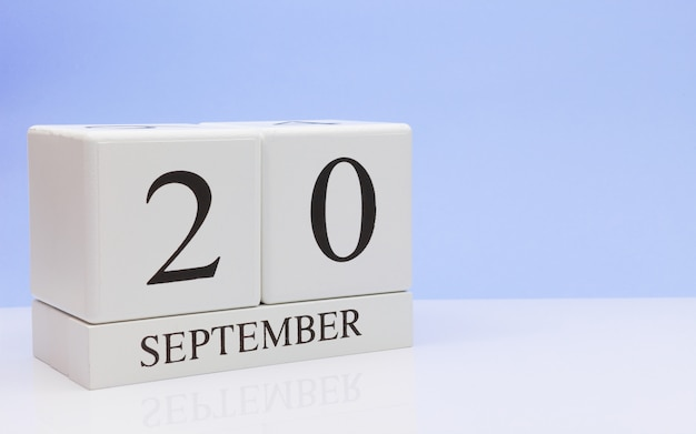 September 20st. day 20 of month, daily calendar on white table with reflection