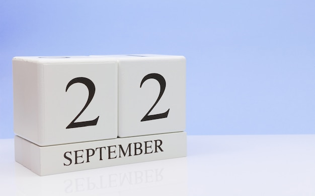 September 22st. day 22 of month, daily calendar on white table with reflection