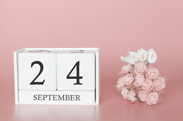 September 24th. day 24 of month. calendar cube on modern pink background, concept of bussines and an importent event.