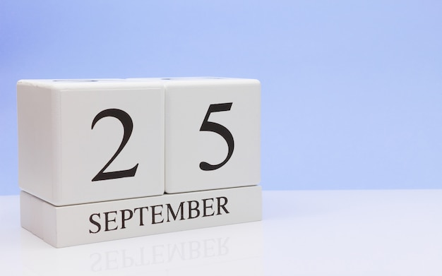 September 25st. day 25 of month, daily calendar on white table with reflection