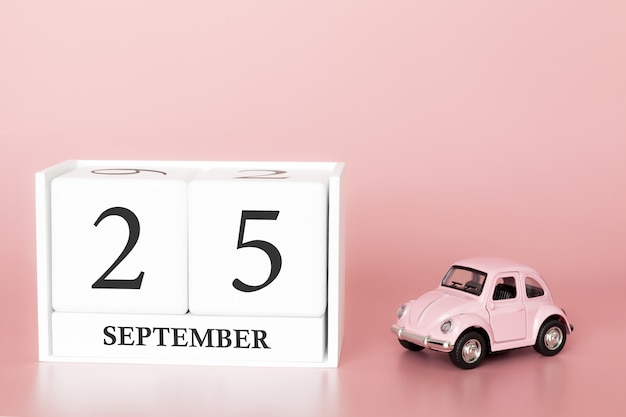 September 25th. day 25 of month. calendar cube with car