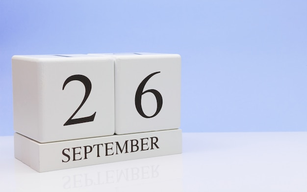 September 26st. day 26 of month, daily calendar on white table with reflection