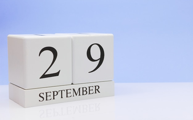 September 29st. day 29 of month, daily calendar on white table with reflection