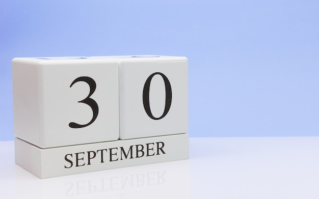September 30st. day 30 of month, daily calendar on white table with reflection