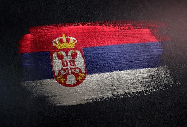 Serbia flag made of metallic brush paint on grunge dark wall