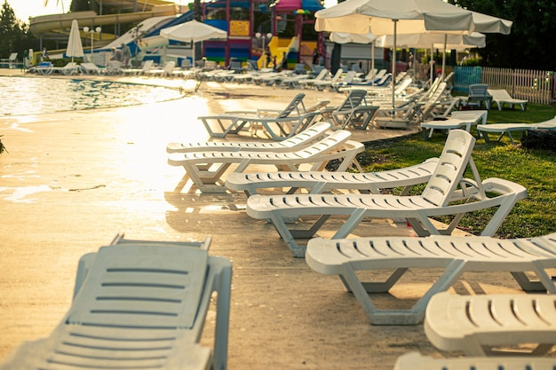 Series of sun beds next to the pool in a turkish hotel